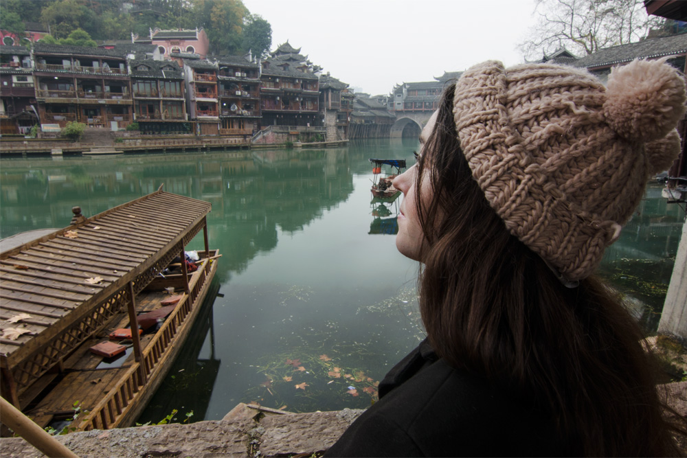 girl looking at river temples, Packing list for China in winter, china winter packing list, what to wear in china winter