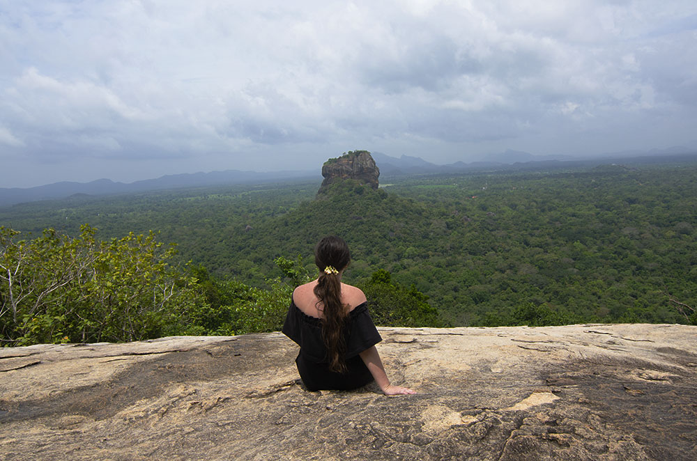 """girl looking at sirigriya"", ""sigiriya lion rock"", ""what to pack for sri lanka"""